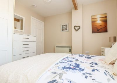The bedroom at The Beach Hut, Ayr