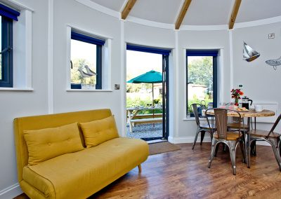 The open-plan living area at The Boat House Roundhouse, East Thorne, Kilkhampton