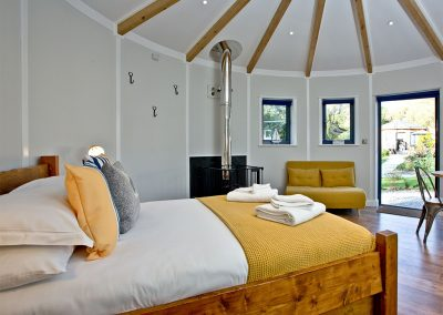 The sleeping area at The Boat House Roundhouse, East Thorne, Kilkhampton