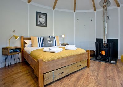The open-plan sleeping area at The Boat House Roundhouse, East Thorne, Kilkhampton