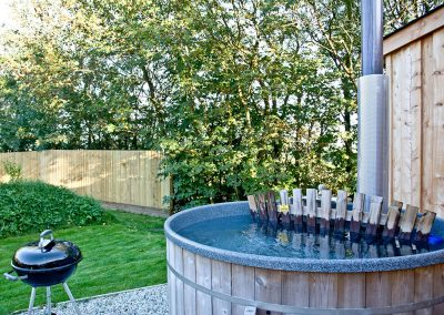 The hot tub & barbecue at The Boat House Roundhouse, East Thorne, Kilkhampton