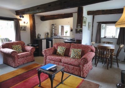 The open-plan living & dining area and kitchen at The Cottage, Great Weeke