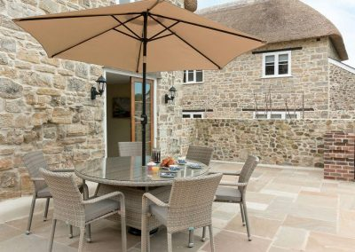 The patio at The Farmhouse at Higher Westwater Farm, Westwater