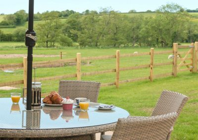 The patio at The Farmhouse at Higher Westwater Farm, Westwater has fantastic garden & countryside views