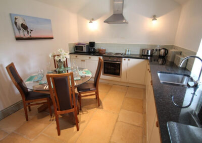 The kitchen & dining area at The Hayloft, Oare