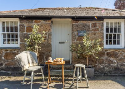At the front of The Langley Tarne, Mousehole is a sunny spot to enjoy dining al fresco & soaking up the sunshine