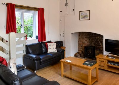 The living area at The Mews, Glebe House Cottages, Bridgerule