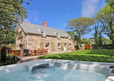 The hot tub, patio & garden at The Old Forge, Bosavern
