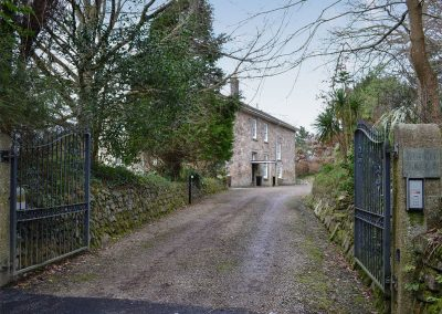 The gated driveway at The Old Vicarage, Lelant