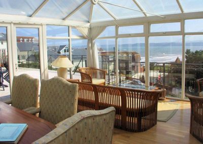 The dining area & conservatory @ 7 Roundham Heights