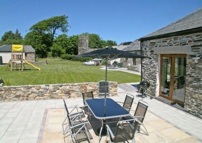 The patio at The Place 2 B, Higher Churchtown Farm, Tresmeer