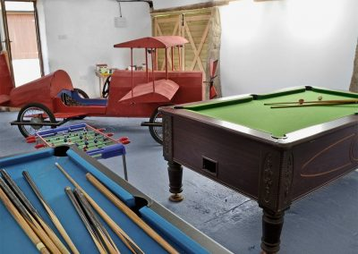 The shared games room at The Place 2 B, Higher Churchtown Farm, Tresmeer