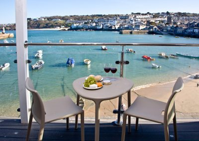The balcony with views across the harbour @ The Poop Deck, 3 Harbour House, St Ives