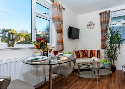The open-plan dining area at The Seashell, Studio 3 Harbour Lights, Brixham