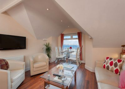 The open-plan living area at The Starfish, 2 Harbour Lights, Brixham