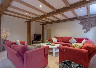 The open-plan living area at The Threshing Barn, Old Manor Farm, Torquay