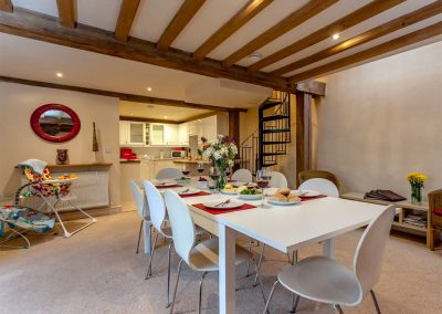 The open-plan dining area at The Threshing Barn, Old Manor Farm, Torquay