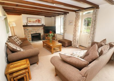 The living area at Tregoninny Vineyard and Woodland Farmhouse, Tresillion