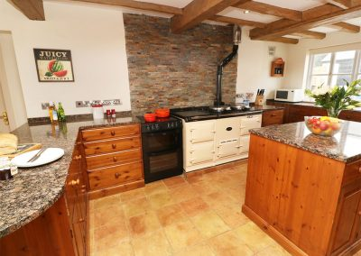 The kitchen at Tregoninny Vineyard and Woodland Farmhouse, Tresillion