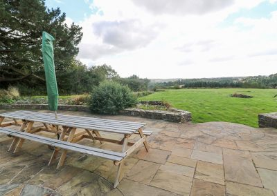 The outdoor patio & garden at Tregoninny Vineyard and Woodland Farmhouse, Tresillion