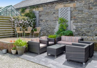 The outdoor sitting area at Trescowthick Barn, St Newlyn East
