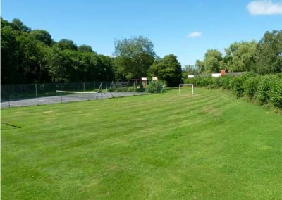 The shared tennis, badminton & children's play area at Trevellard Belle, Notter