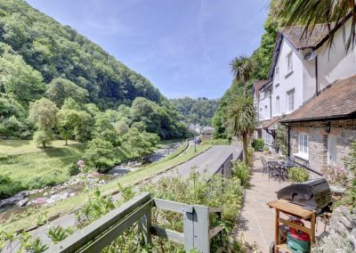 The terrace & barbecue area at Watersmeet Cottage, Lynmouth