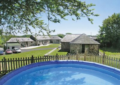 The shared swimming pool at What a Beauty, Higher Churchtown Farm, Tresmeer