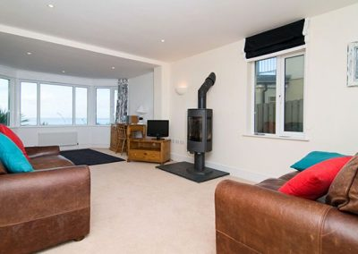 An additional living area with woodburner @ Windwards, St Ives