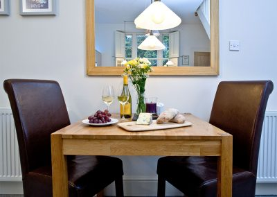 The dining area at Wisteria Cottage, Cockington Cottages, Cockington