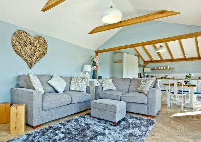 The living area at Woodland View Lodge, Shute
