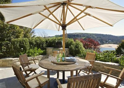 The outdoor patio & barbecue area at Woodwell, Salcombe