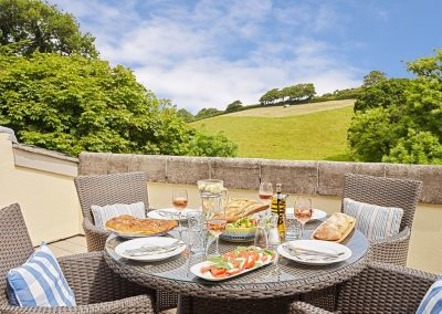The decked terrace at Yennadon Cottage, Gitcombe House Country Cottages, Cornworthy